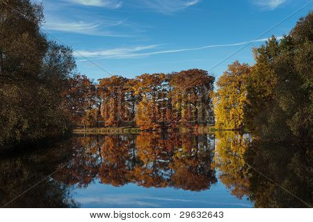 Autumn Landscape Of Calm River And Bright Trees