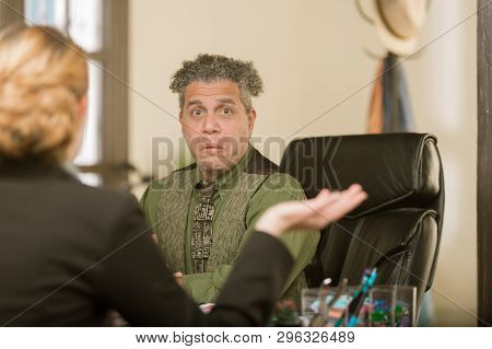 Creative Man Reacting At His Desk With Client Or Colleague