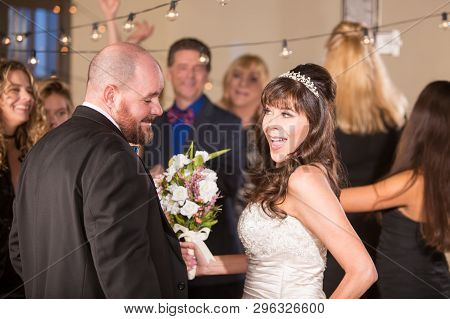 Bride Dancing With Handsome Man At Her Wedding Reception
