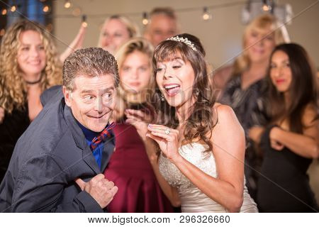 Bride And Man Doing Chicken Dance At A Wedding
