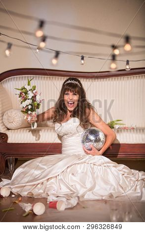 Unhappy Bride Yelling And Wielding Her Wedding Bouquet