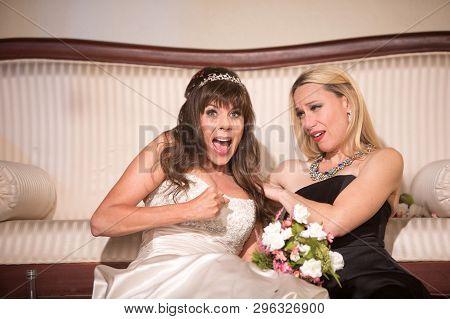 Friend Comforting Sad Bride At A Wedding