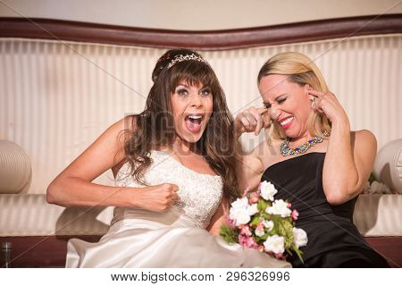 Friend With Screaming Bride At A Wedding Reception