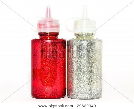 Two bottles of red and silver glitter sparkles