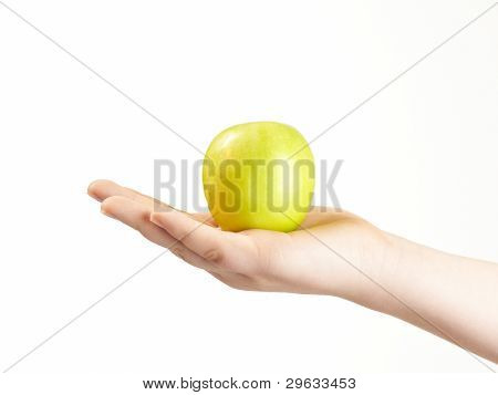 Apple in the palm of childs hand