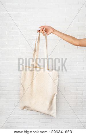 Female Hand Holding Eco Bag On White Background