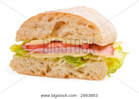 Ham, Cheese And Tomatoes Sandwich Sliced In Half