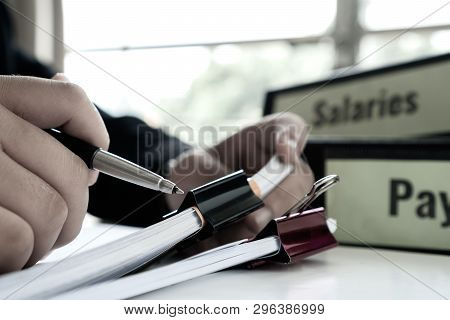 Document Report Or Business Management Concept: Businessman Manager Hands Holding Pen For Reading, S