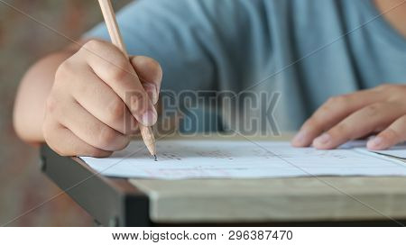 Exam Test School Or University Concept : Hand Student Holding Pencil Writing Standardized Answer Mul