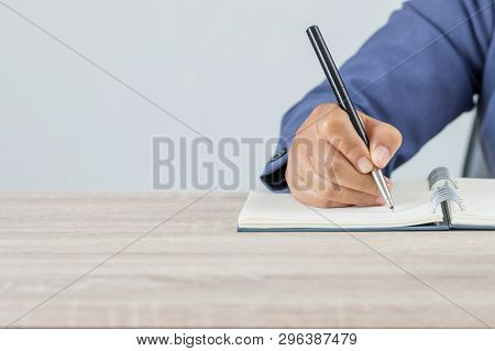 Adult Student University Study In Class And Hand Note Lecture In Open Notebook For Exam. Adults Educ