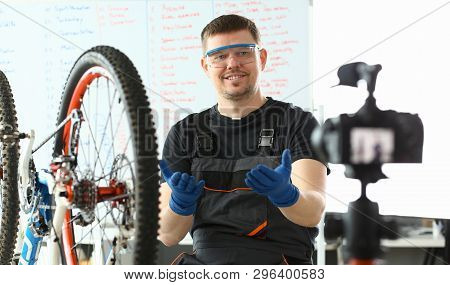 Joyful Engineer Taking Care Of Mountain Bicycle. Blogger Mechanic In Protective Glasses And Gloves D