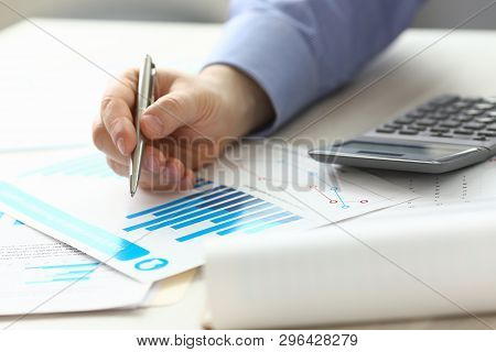 Accountant Manager Controlling Expense Income. Man Hold Pen At Work Table, Check Financial Data With