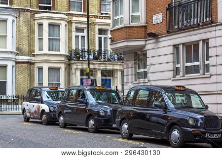 London, Great Britain. April 12, 2019. Kensington Street. Cab Parking. London Cab Is Considered The
