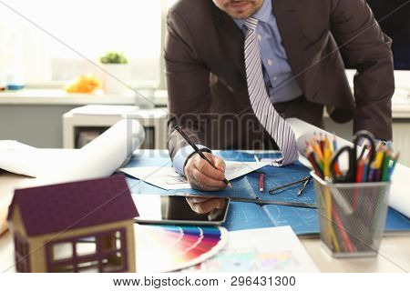 Workman Drafting Building Reconstruction Project. Architecture Designing Concept. Civil Engineer Writing on Blueprint. Man in Suit Drawing House Layout at Office Workplace Medium Shot poster