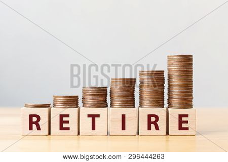 Coins On Stack Stair As Step Growing Growth And Wooden Cube Block With Word Retire. Money Pension Re
