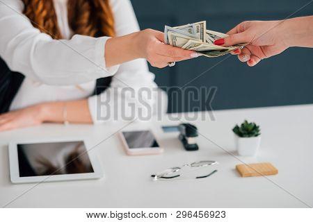 Do Business Online, Get Cash Salary. Female Extending Dollar Bills. Making Money On Internet. Income