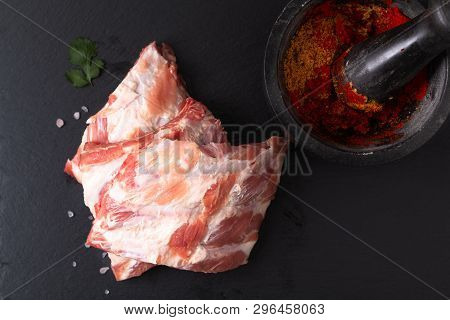 Foos Concept Organic Raw Pork Ribs On Black Slate Board With Copy Space