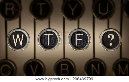 Close Up Of Old Manual Typewriter Keyboard With Scratched Chrome Keys That Spell Out
