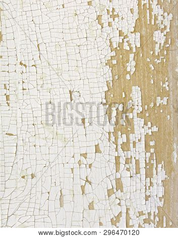 Background Of Aging, Cracked White Paint Flaking Off And Exposing Bare Wood.