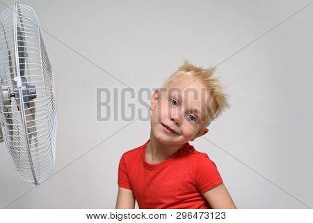 Pretty Blond Boy In Red Shirt Enjoying The Cool Air. Summer Concept.