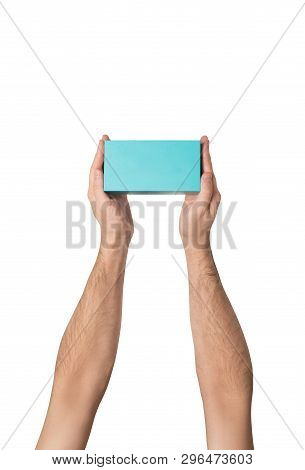 Rectangular Turquoise Box In Male Hands. Top View. Isolate