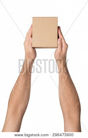 Small Parcel In Male Hands. Top View. White Table On The Background