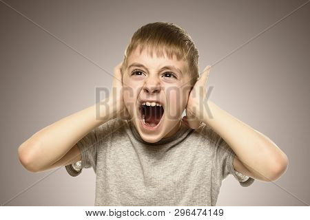 Boy Closed His Ears With His Hands And Shouts Furiously. Naughty Schoolboy. Fear