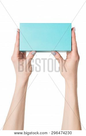 Rectangular Turquoise Box In Female Hands. Top View. Isolate