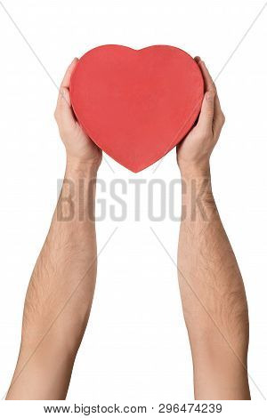 Male Hand Holding A Red Box In The Shape Of A Heart. Isolate On White Background.