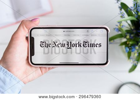 Kharkiv, Ukraine - April 10, 2019: Apple Iphone X In Female Hand With Nytimes.com Site On The Screen