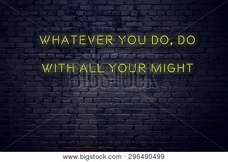 Positive Inspiring Quote On Neon Sign Against Brick Wall Whatever You Do Do With All Your Might.