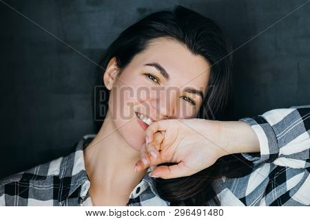 Young Woman Portrait. Relaxed Posture. Happy And Friendly Beautiful Brunette. Easygoing Millennial I
