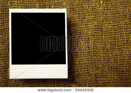 Single old photo over the textile surface