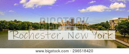 Rochester, New York, Usa Skyline Viewed From The South At Dusk With The Genesee River Flowing Toward