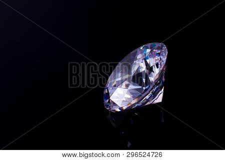 Elegant Chic Crystal On A Black Mirror Surface With A Reflection Of A Diamond