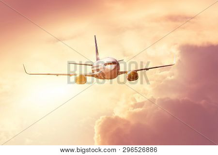 Flying And Traveling Holiday, Sunset Bright Sun Shine Glare In The Evening Voyage Flight Airplane