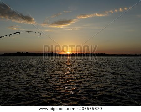 A Tranquill Orange Coloured Cumulus Cloudy Sunset Seascape Over Sea Water With Water Reflections. Qu