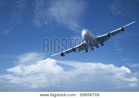 Jet Is Maneuvering In A Blue Cloudy Sky