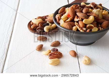 Mix Nuts And Dried Fruits Background And Wallpaper. Seen From Side View Of Mix Nuts And Dried Fruits