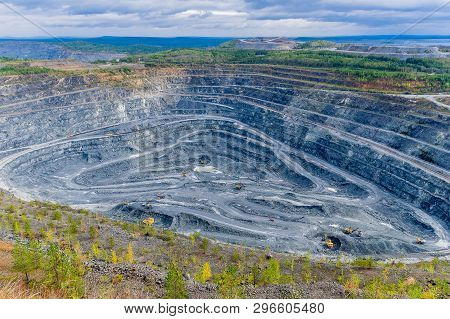 Of Opencast Mining Quarry, Open Pit Mining With Many Machines At Work, This Area Has Been Mined For