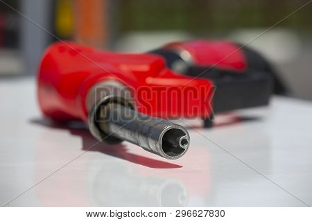 Gasoline Pistol Pump Fuel Nozzle Gas Station Pump. Man Refueling Gasoline With Fuel In A Car, Holdin