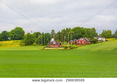 Traditional Colored Wooden House In Norway At Summer Day. Country Houses In Village In Norway. Tradi