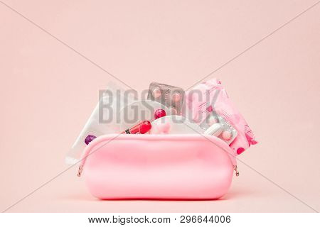 Women intimate hygiene products - sanitary pads and tampons on pink background, copy space. Menstrual period concept. Top view, flat lay, copy space poster