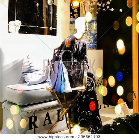Paris, France - 12 January 2019 Mannequin Woman In Beautiful Gown, Sitting Dummy In Shop Window With