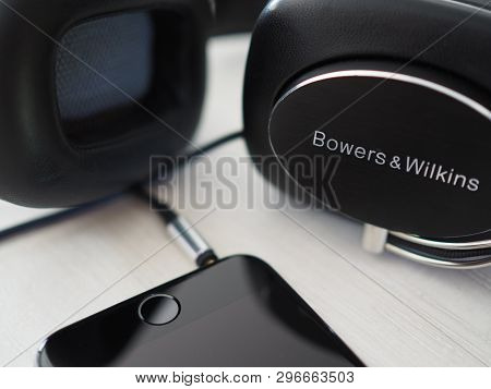 Hoeilaart, Belgium - May 9 2017: A Bowers And Wilkins P7 Headphone Connected To An Apple Iphone 6.
