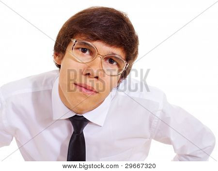 Funny geek in white shirt, tie and big freaky glasses standing and looking closeup over isolated background. Mask included