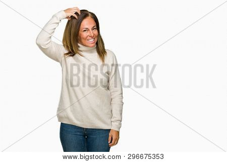 Beautiful middle age adult woman wearing winter sweater over isolated background confuse and wonder about question. Uncertain with doubt, thinking with hand on head. Pensive concept.