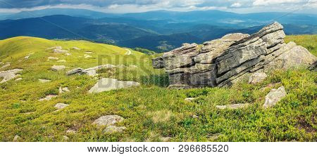 Morning Scenery In Mountains. Wonderful Summer Landscape With Rocks On Grassy Hills. Overcast Sky Ab