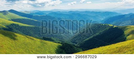 Panorama Of Rolling Hills Of The Ridge In Summer. Valley Down Below. Grassy Alpine Slopes. Sunny Wea
