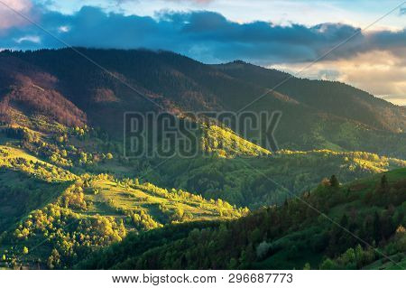 Rural Countryside In Mountains. Agricultural Fields On Hills. Wonderful Springtime Landscape On A Cl